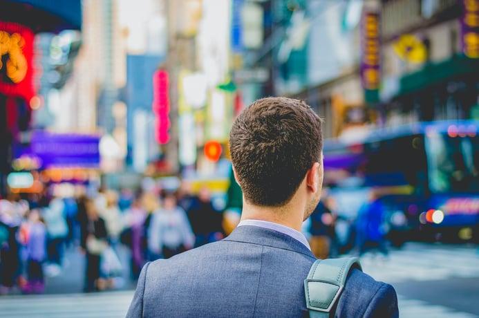 Business man walking on street