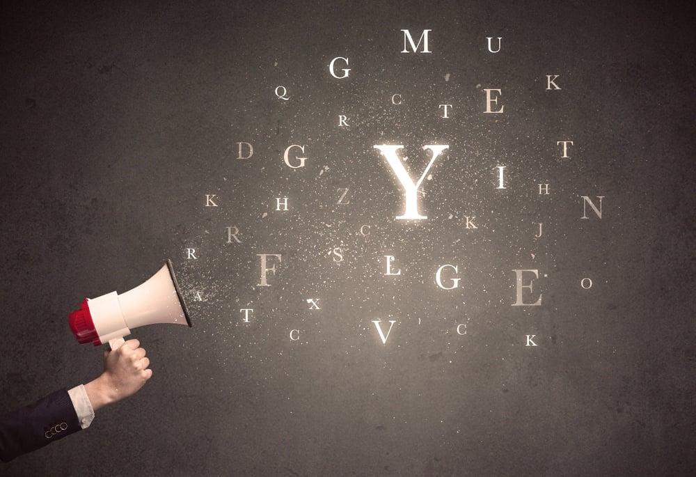 megaphone spraying alphabet letters