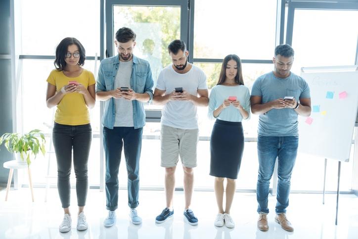 Millennials looking at their phone