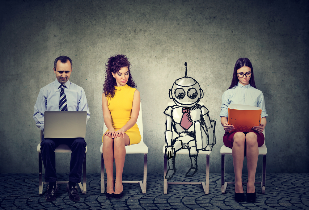 People sitting with robot