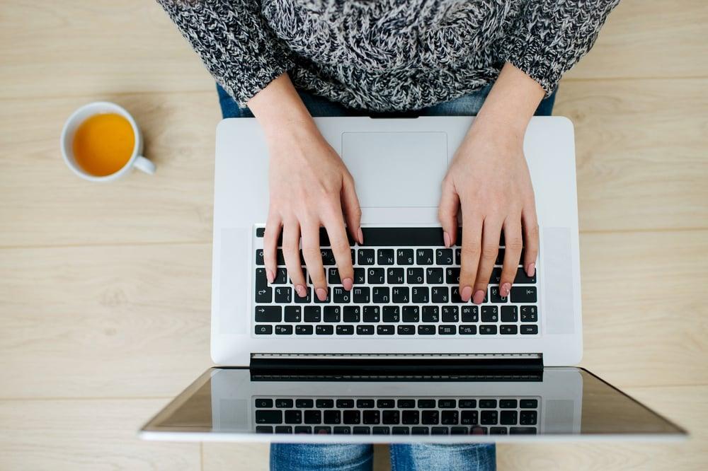 Women typing on laptop computer
