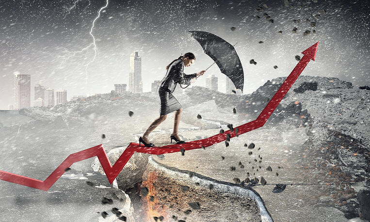 business woman weathering a storm