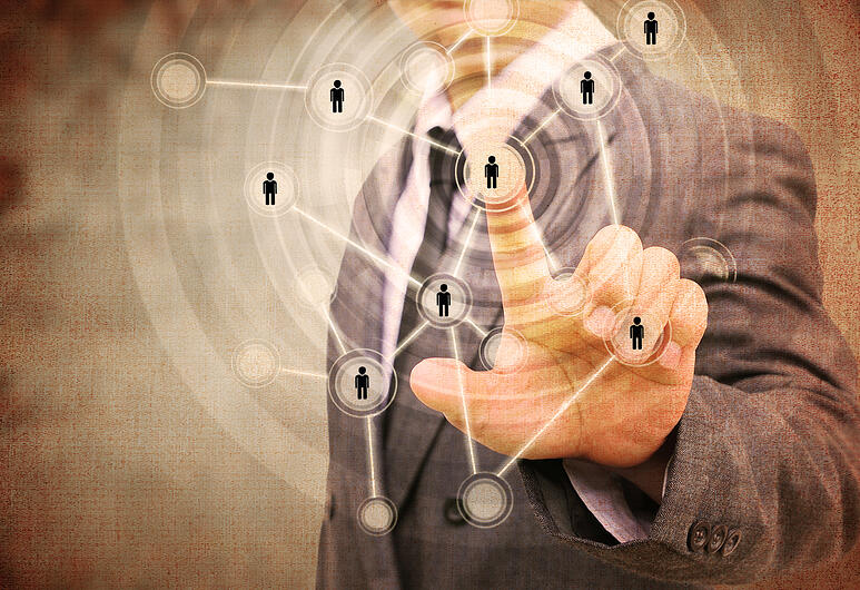 man pointing to network of people shutterstock_227931460