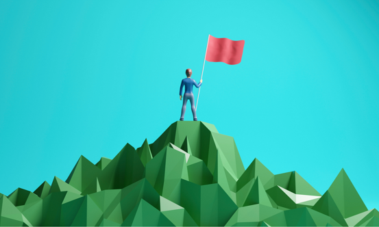 man with flag on a mountain