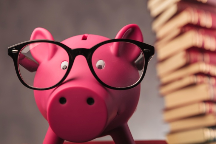 piggy bank with reading glasses