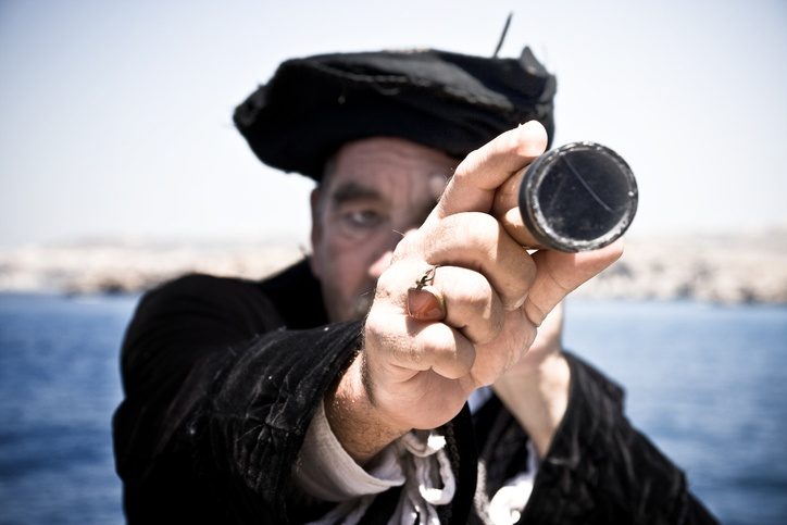 Pirate man with telescope