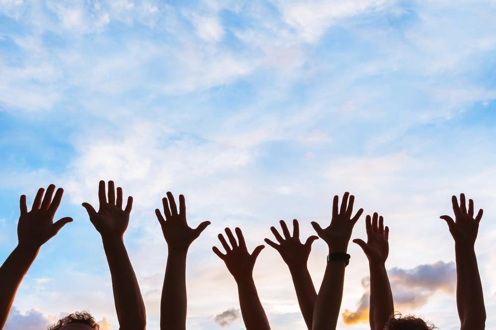 hands of happy employees