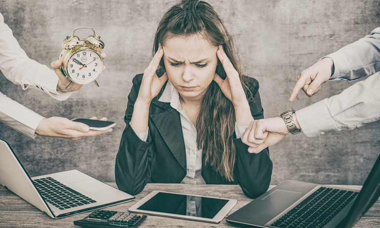 woman that cant focus on work shutterstock_618066920